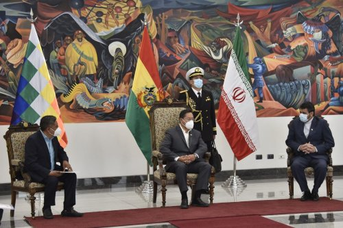 Bolivian President Luis Arce (C) and Foreign Minister Rogelio Mayta (L) talk with Iran's new ambassador to Bolivia, Mortessa Tabreshi, during the credentials ceremony in La Paz, on November 11, 2020. (Photo by Aizar RALDES / AFP) (Photo by AIZAR RALDES/AFP via Getty Images)