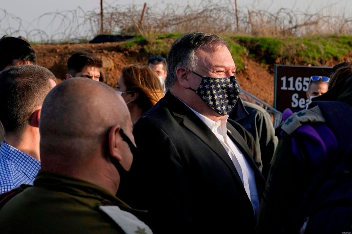US Secretary of State Mike Pompeo (C) arrives for a security briefing on Mount Bental in the Israeli-annexed Golan Heights, near Merom Golan on the border with Syria, on November 19, 2020. - US Secretary of State Mike Pompeo became the first top American diplomat to visit a West Bank Jewish settlement and the Golan Heights, cementing Donald Trump's strongly pro-Israel legacy. (Photo by Patrick Semansky / POOL / AFP) (Photo by PATRICK SEMANSKY/POOL/AFP via Getty Images)