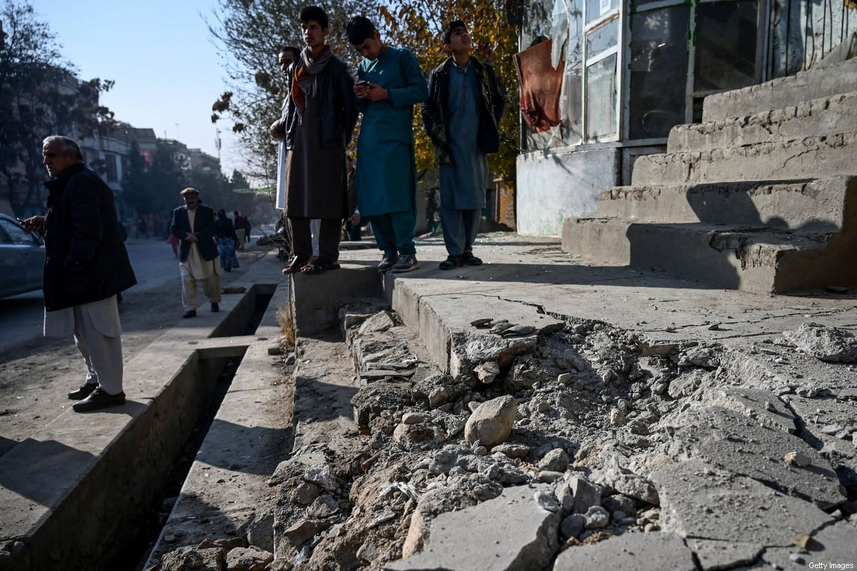 Residents gather at a site after several rockets land at Khair Khana, north west of Kabul on November 21, 2020. - A series of loud explosions shook central Kabul on November 21, including several rockets that landed near the heavily fortified Green Zone where many embassies and international firms are based, officials said. (Photo by WAKIL KOHSAR / AFP) (Photo by WAKIL KOHSAR/AFP via Getty Images)