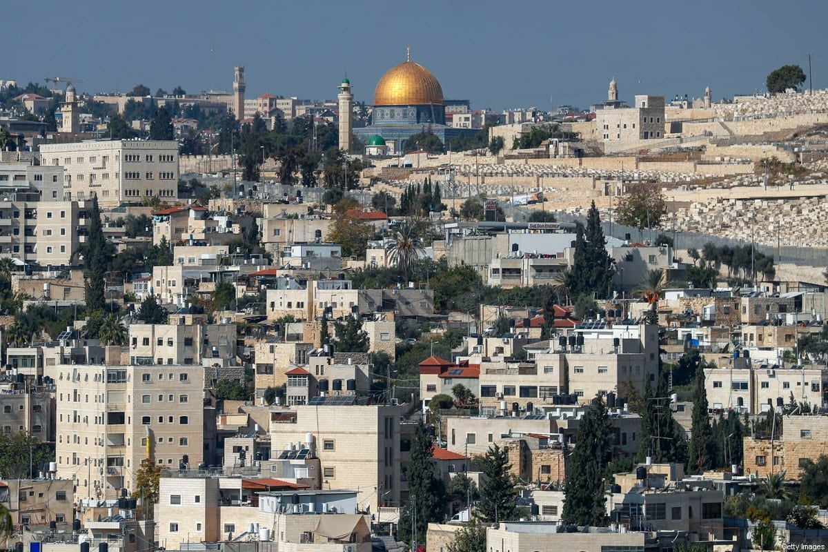 A picture taken from the West Bank town of Abu Dis, separated from Jerusalem by Israel's controversial barrier, shows the Dome of the Rock (top) in Jerusalem's al-Aqsa mosque compound and the Jewish cemetary of Mount of Olives (R), on 23 November 2020. [AHMAD GHARABLI/AFP via Getty Images]