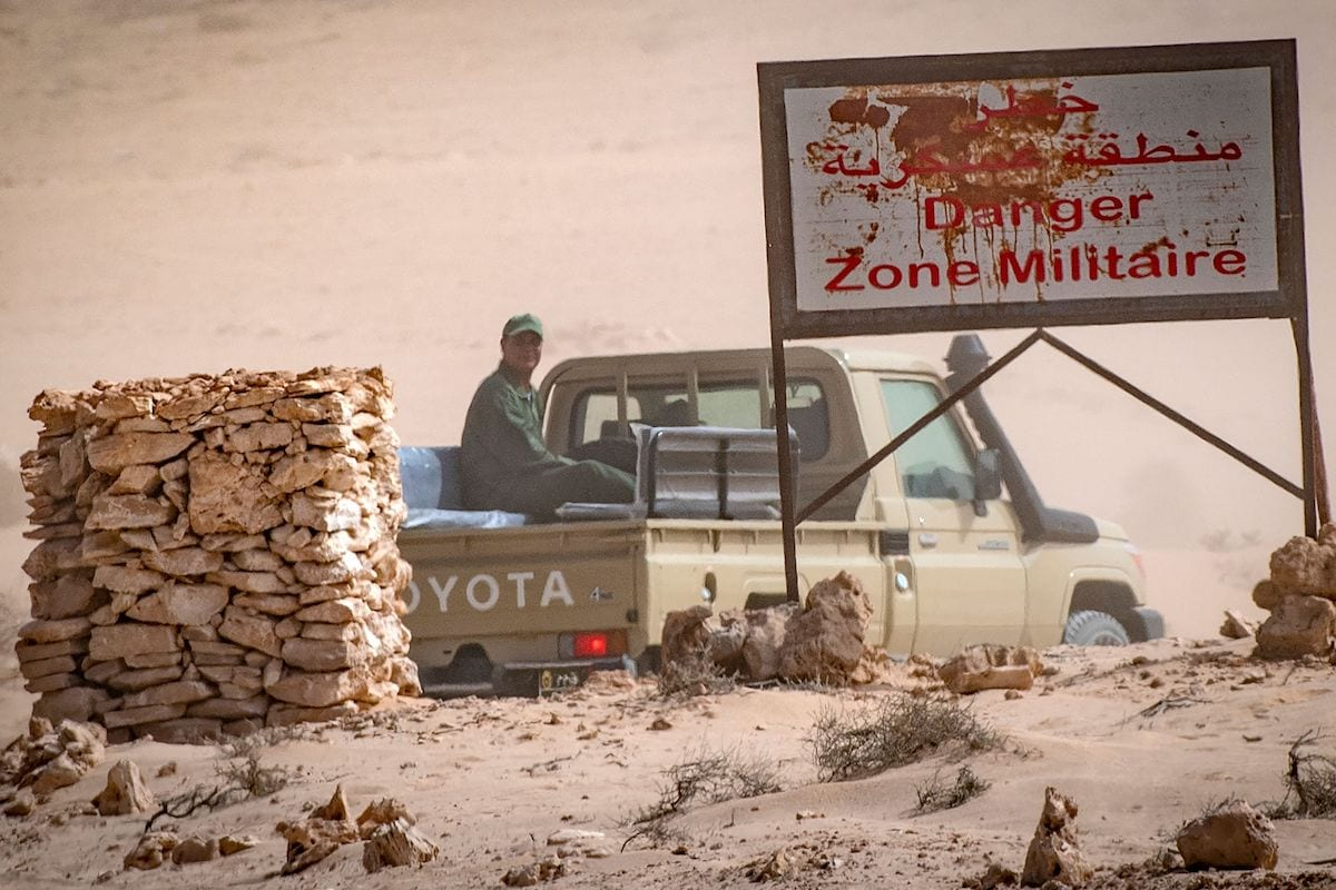 A vehicle of the royal Moroccan armed forces is seen on the Moroccan side of border crossing point between Morocco and Mauritania in Guerguerat located in the Western Sahara, on 25 November 2020, after the intervention of Moroccan army in the area. [FADEL SENNA/AFP via Getty Images]