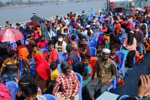 Rohingya refugees board a Bangladesh Navy ship to be transported to the island of Bhashan Char in Chittagong on 4 December 2020. [AFP via Getty Images]