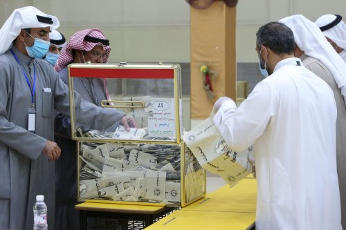 A Kuwaiti judge (2nd L) and his aides count the ballots at a polling station at the end of the parliamentary elections vote, in the Abdullah al-Salem district of Kuwait city on December 5, 2020. - Kuwaitis hoping for reform went to the polls in a parliamentary election overshadowed by COVID-19, with facilities laid on so citizens infected with the disease could vote in special polling stations. (Photo by YASSER AL-ZAYYAT / AFP) (Photo by YASSER AL-ZAYYAT/AFP via Getty Images)