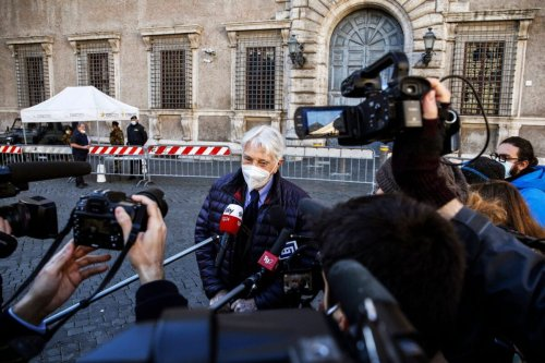 """Italian journalist and writer Corrado Augias talks with journalists in front of the French Embassy in Rome on December 14, 2020, as he arrive to return his Legion of Honor medal to the French ambassador. - Augias announced on December 13,2020 that he would return his Legion of Honor to the French ambassador, in protest to that granted to Egyptian President Abdel Fattah al-Sisi, described as """"an accomplice of atrocious criminals"""". """"In my opinion, President French Macron should not have granted the Legion of Honor to a Head of State who objectively became an accomplice of atrocious criminals. I say this in memory of poor Giulio Regeni, but also for France, for the importance that this distinction still represents, two centuries after having been established """", talks Augias, decorated in 2007. (Photo by FABIO FRUSTACI / ANSA / AFP) (Photo by FABIO FRUSTACI/ANSA/AFP via Getty Images)"""