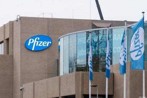 A poster in the window of the Pfizer Pharmaceutical Company of Puurs, visible from the highway, lets motorists know that the company is hiring staff on November 10, 2020 in Puurs, Belgium. [Jean-Christophe Guillaume/Getty Images]