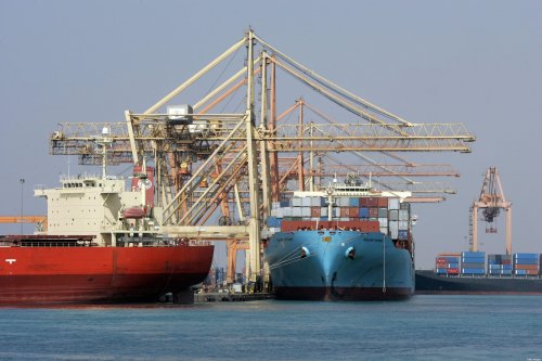 Cranes unload containers from the deck of ships in the Jeddah Port, 13 December 2007 [ROSLAN RAHMAN/AFP via Getty Images]
