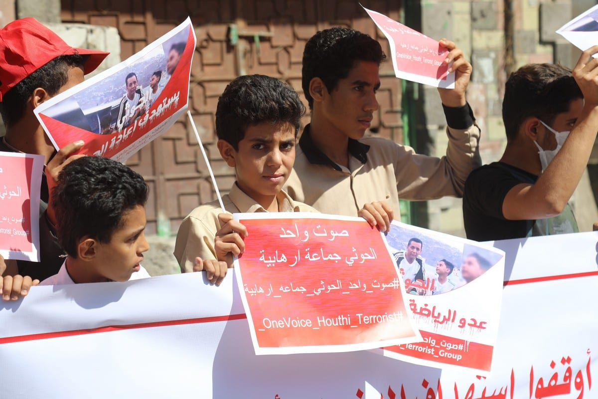 "Yemenis hold placards during a protest to demand Iran-backed Houthis to be listed as a "" terror organization"" at a stadium in Taiz, Yemen on 13 December 2020. [Abdulnasser Alseddik - Anadolu Agency]"