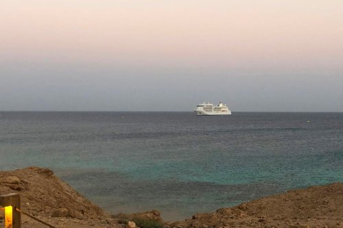 The Silver Spirit cruise ship is pictured anchored off the Sindala island, one of two islands which form Saudi's planned NEOM megaproject on on 29 September 2020 [ANUJ CHOPRA/AFP/Getty Images]