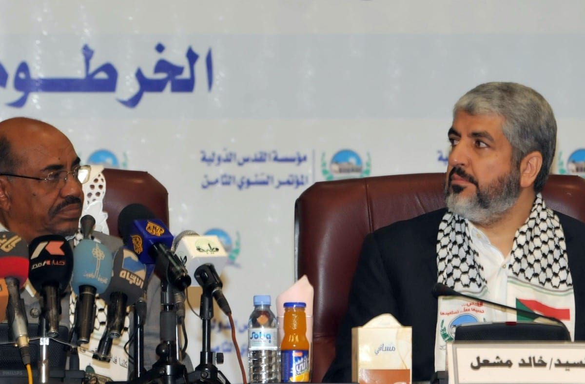 Exiled Hamas chief Khaled Meshaal (R) sits next to former Sudanese President Omar al-Beshir during the opening of the eighth Al-Quds (Jerusalem) International Foundation conference in the Sudanese capital Khartoum on 6 March 2011 [EBRAHIM HAMID/AFP via Getty Images]