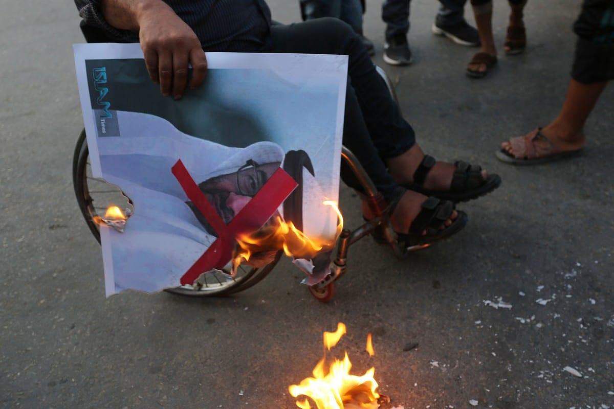 Palestinian protester burn a portrait of Abu Dhabi Crown Prince during a protest against Israeli normalisation among Arab states in Gaza on 23 September 2020 [Ashraf Amra/ApaImages]