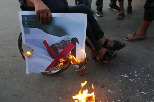 Palestinian protester burn a portrait of Abu Dhabi Crown Prince during a protest against Israeli normalisation among Arab states in Gaza on 23 September 2020 [Ashraf Amra/ApaImages]