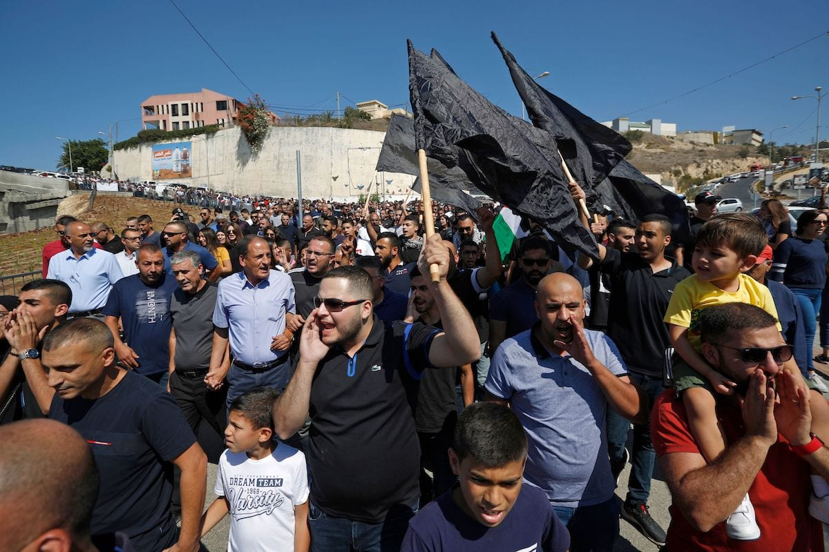 Israeli Arabs protest against violence, organised crime and recent killings among their communities, in the Arab town of Umm-Al Fahm in Northen Israel on October 4, 2019 [JALAA MAREY/AFP via Getty Images]