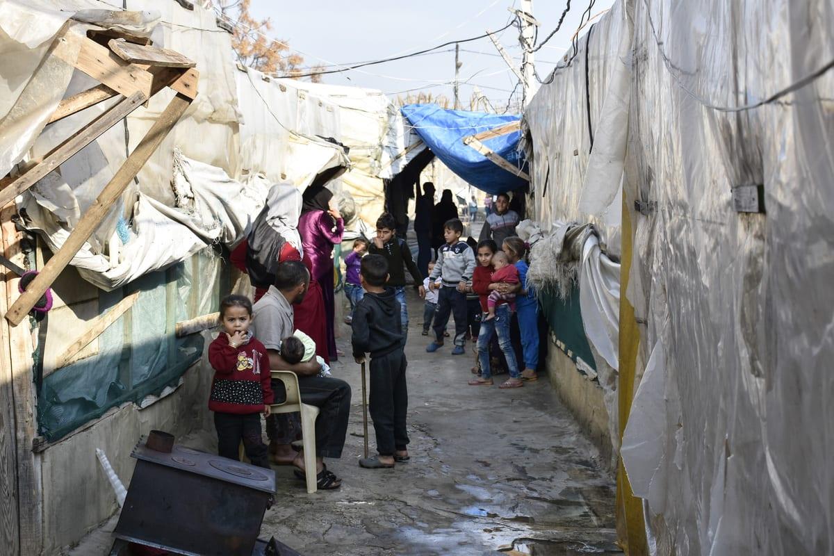 Syrian kids are seen in a refugee camp in Tripoli, Lebanon on 3 January 2021 [Mahmut Geldi/Anadolu Agency]