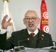 Ghannouchi has not handed power over to deputy, adviser says