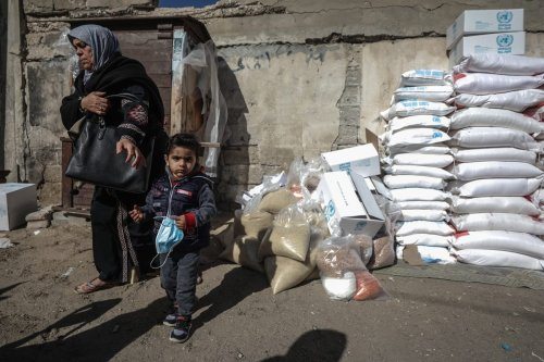 UNRWA aid packages in Gaza on 14 January 2021 [Ali Jadallah/Anadolu Agency]