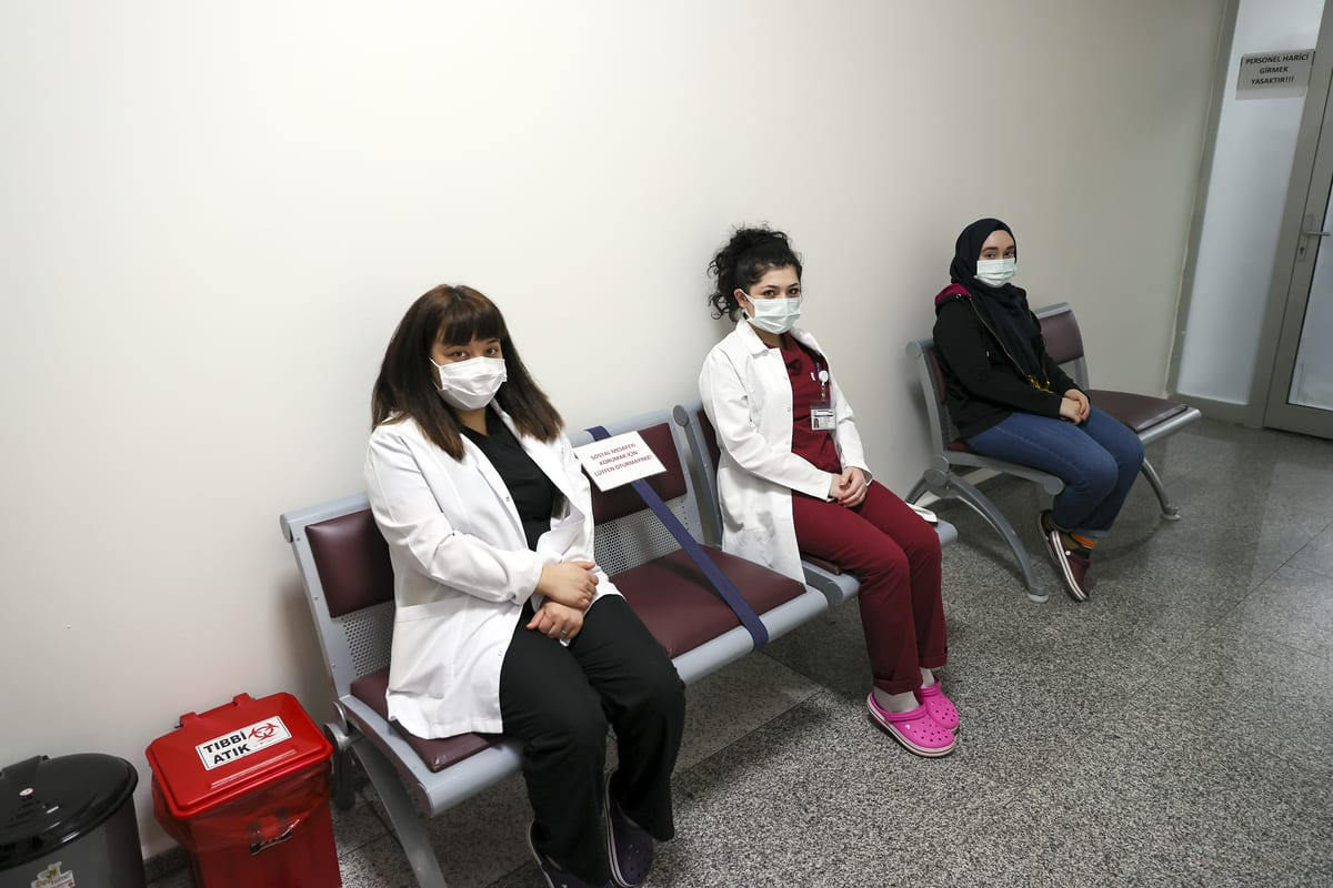 "Health workers wait to get vaccinated with the first dose of the CoronaVac vaccine against coronavirus (Covid-19) pandemic after the vaccine was issued ""Emergency Use Authorization"" in at Ibni Sina Hospital Ankara, Turkey on January 15, 2021 [Halil Sağırkaya/Anadolu Agency]"