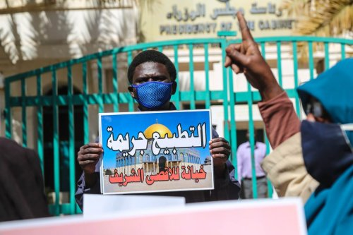 Sudanese people rally against their country's recent signing of a deal on normalising relations with Israel, outside the cabinet offices in the capital Khartoum, Sudan on January 17, 2021 [Mahmoud Hjaj/Anadolu Agency]