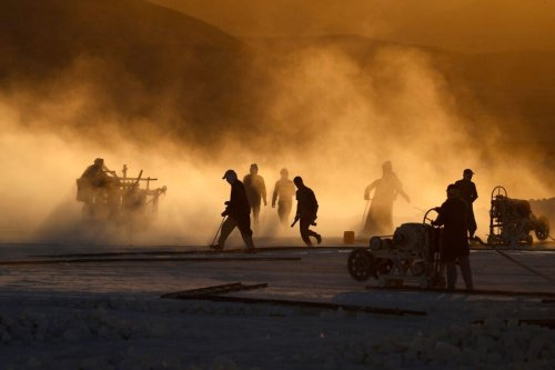 """TOPSHOT - Labourers work at the """"White Mountain"""" limestone extraction quarry site near Egypt's southern city of Minya, some 265 kilometres south of the capital, on December 7, 2019. - Covered in fine white dust, labourers at a limestone quarry in southern Egypt toil in brutal conditions with little workplace safety for paltry pay. Labourers work in shifts at the quarry in the so-called White Mountain east of the river Nile outside Minya, about 265 km south of the capital Cairo. (Photo by Khaled DESOUKI / AFP) (Photo by KHALED DESOUKI/AFP via Getty Images)"""