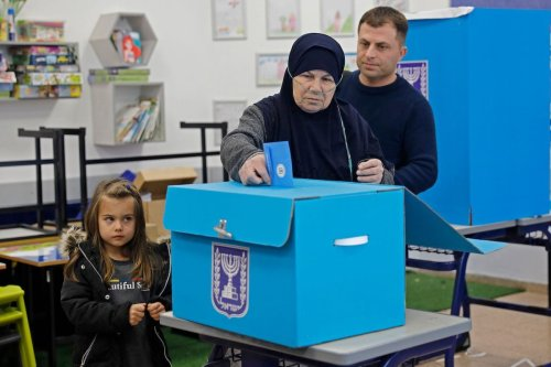 An Arab Israeli woman votes in the country's parliamentary elections at a polling station in the Arab city of Tamra in northern Israel on 2 March 2020. [AHMAD GHARABLI/AFP via Getty Images]