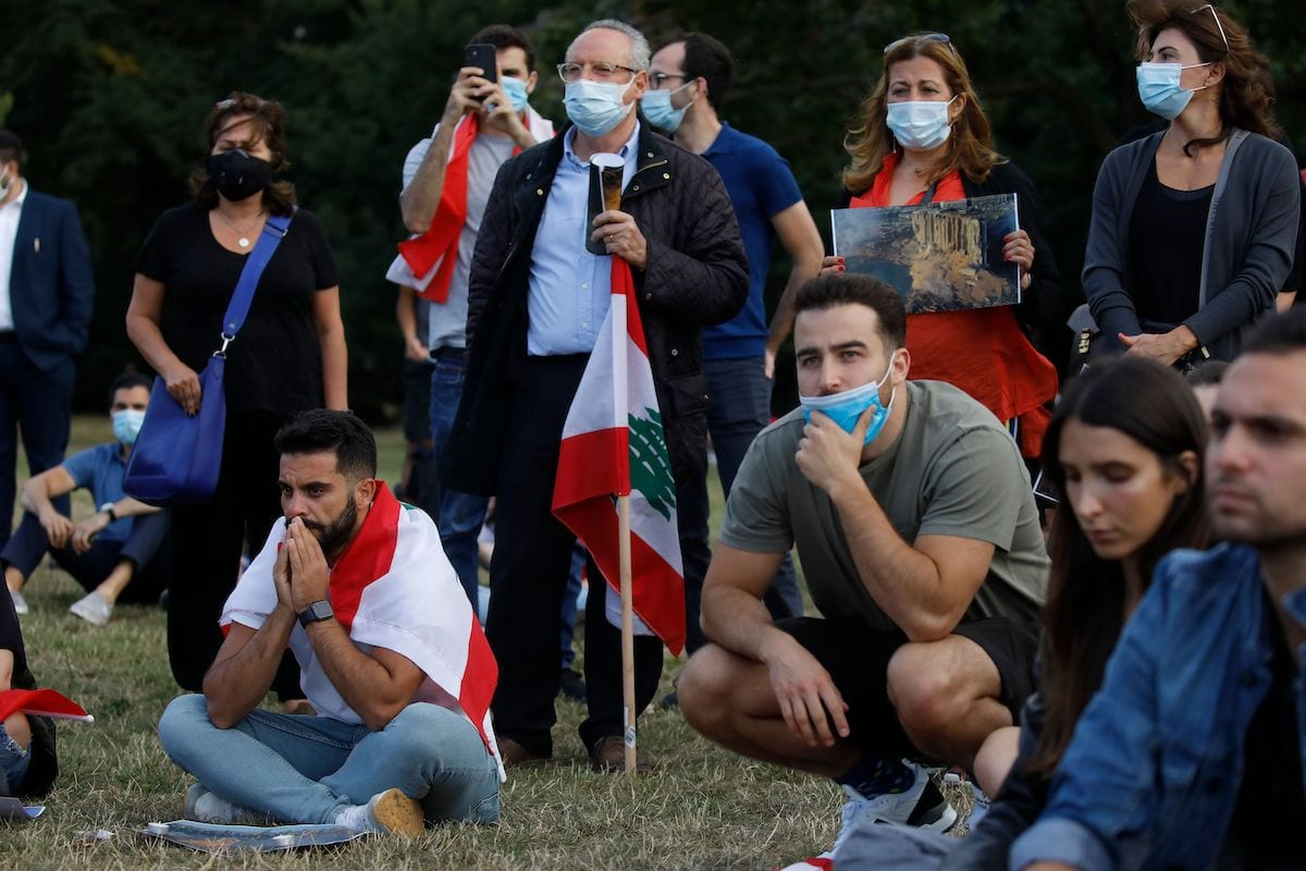 Lebanese come together for a vigil held at Kensington gardens in central London to honour the victims of the Beirut blast on 5 August 2020. [TOLGA AKMEN/AFP via Getty Images]
