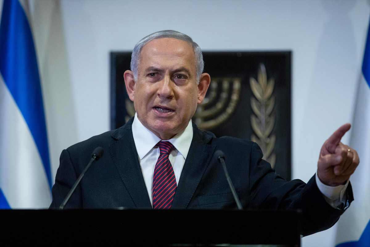 Israeli Prime Minister Benjamin Netanyahu delivers a speech at the Knesset (Israeli Parliament) in Jerusalem on 22 December 2020. [YONATHAN SINDEL/POOL/AFP via Getty Images]