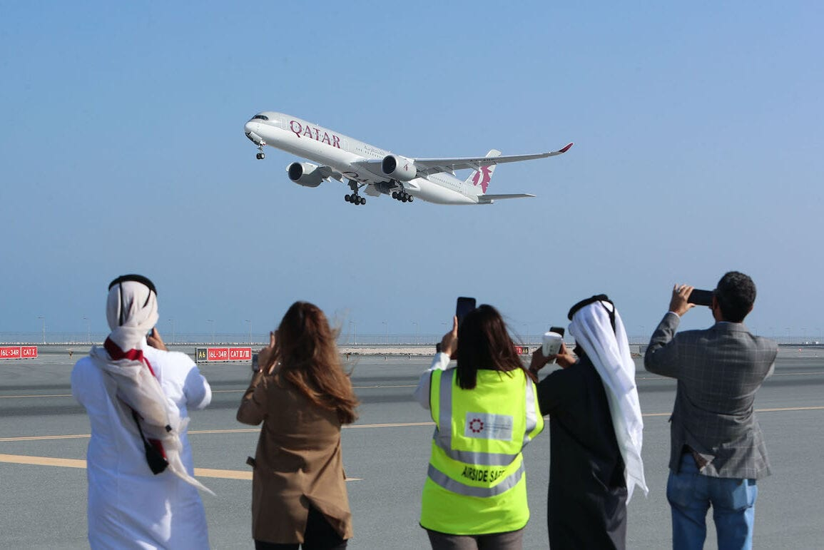 A Qatar Airways airplane takes off from Hamad International Airport near the Qatari capital Doha, on the first commercial flight to Saudi Arabia in three and a half years following a Gulf diplomatic thaw, on 11 January 2021. [KARIM JAAFAR/AFP via Getty Images]