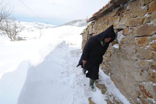 A man walks along a path following heavy snowfall in the village of Medea, 100km south of Algiers, on February 14, 2012 [FAROUK BATICHE/AFP via Getty Images]