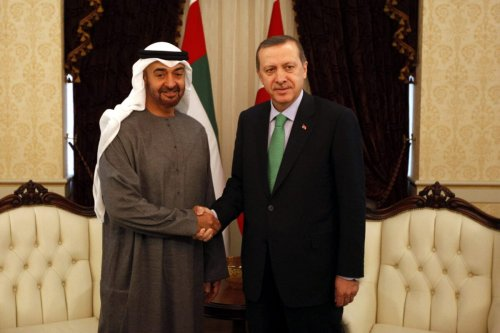 Abu Dhabi's Crown Prince Sheikh Mohammed bin Zayed Al Nahyan (L) shakes hands with Turkey's Prime Minister Recep Tayyip Erdogan before a meeting in Ankara on February 28, 2012. AFP PHOTO/POOL/Umit Bektas (Photo credit should read UMIT BEKTAS/AFP via Getty Images)