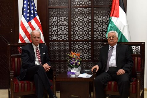 US Vice Presicent Joe Biden (R) and Palestinian president Mahmud Abbas sit during a meeting at the presidential compound in the city of Ramallah, in the West Bank, on 9 March 2016. [AFP via Getty Images]