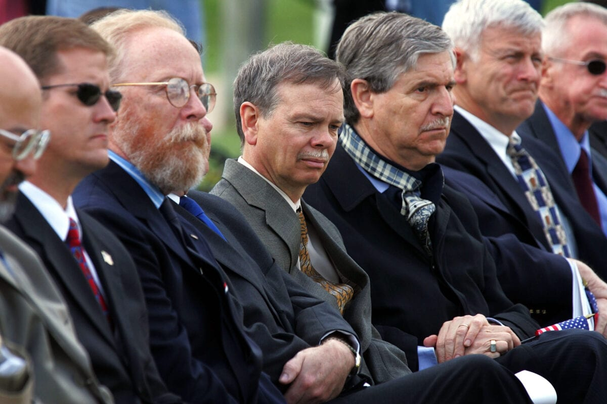 ARLINGTON, VA - APRIL 25: (L-R) Former Iranian hostages Steven Kirtley, Don Hohman, Steven Lauterbach, John Limbert and Paul Needham sit together during the 25th anniversary remembrance ceremony to honor the eight U.S. servicemen who died during the 1980 attempt to free them April 25, 2005 at Arlington National Cemetery in Arlington, Virginia. Eight Americans were killed April 25, 1980 in the failed attempt to rescue the 53 U.S. hostages who were being held by Iranian radicals at the U.S. Embassy in Tehran. (Photo by Joe Raedle/Getty Images)