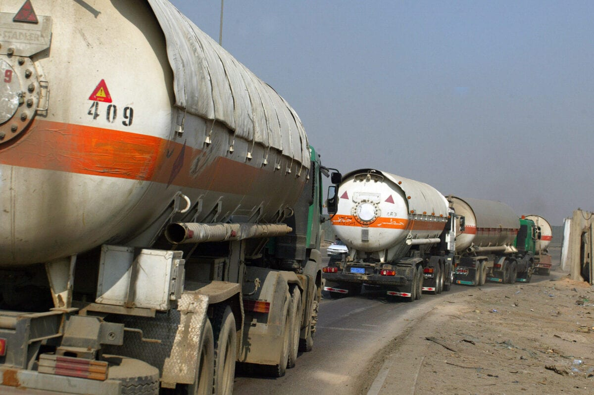 Oil tankers drive in convoy along a highway close to the Dora oil refinery in southern Baghdad on November 02, 2008 [ALI YUSSEF/AFP via Getty Images]