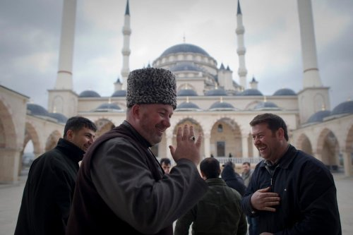 Men smile near Grozny's main mosque in Russia on 7 March 2011 [DMITRY KOSTYUKOV/AFP/Getty Images]