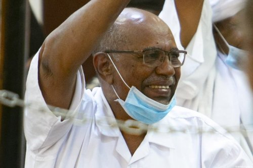 Sudan's ousted president Omar al-Bashir (C) appears during his trial along with others over the 1989 military coup that brought them to power, at a courthouse in the capital Khartoum, Sudan on 19 January 2021 [Mahmoud Hjaj/Anadolu Agency]