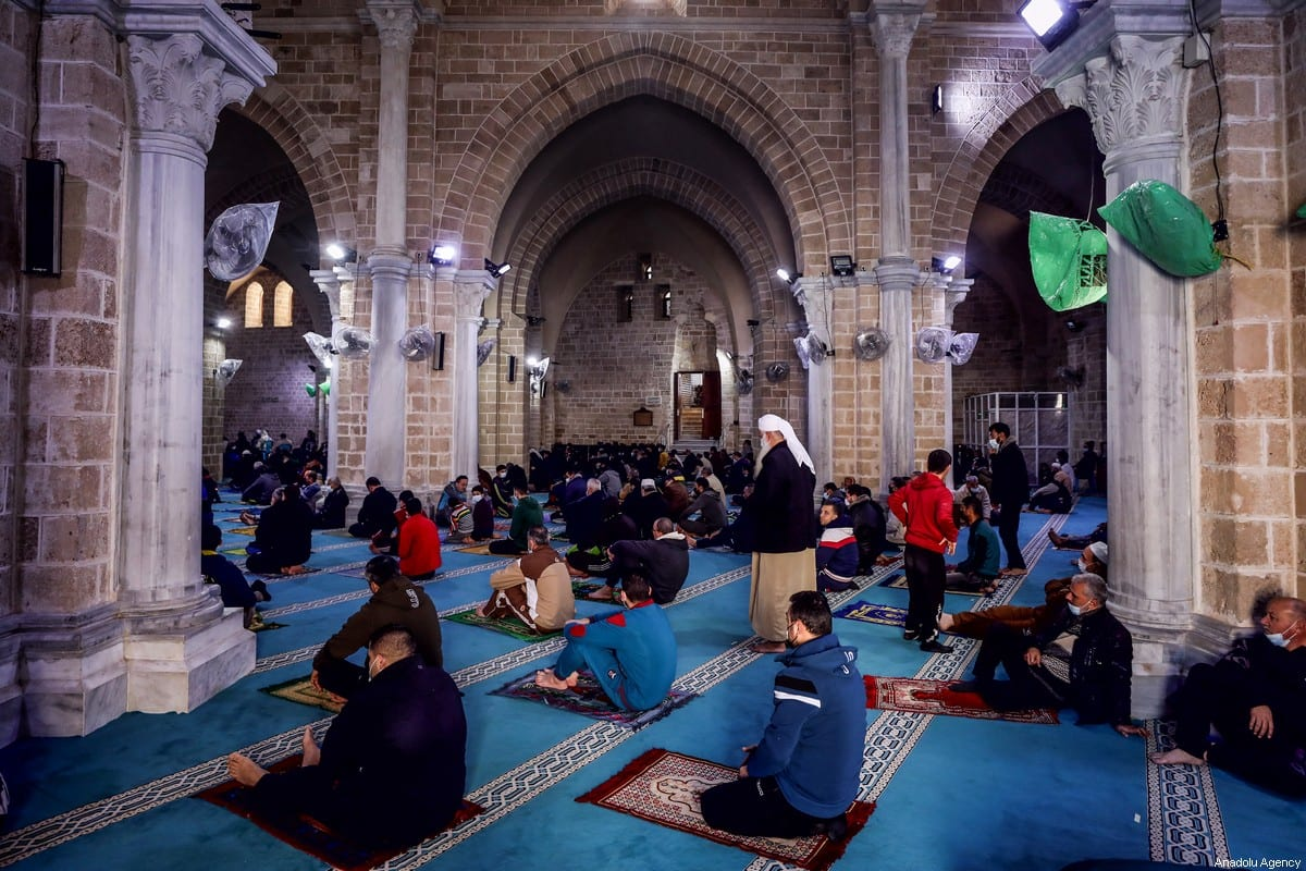 GAZA CITY, GAZA - JANUARY 22: People perform Friday prayer at Grand Omer Mosque after Covid-19 measures began to be eased gradually in Gaza City, Gaza on January 22, 2021. Friday prayers are allowed in mosques as the curfew continued in the city. ( Ali Jadallah - Anadolu Agency )