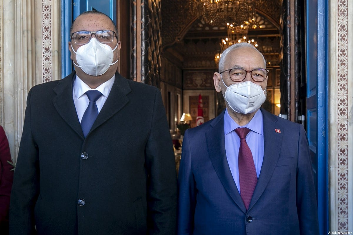 Tunisian Prime Minister Hichem Michichi (L) and Tunisian Parliament Speaker Rached Ghannouchi (R) arrive to attend the session of a confidence vote on the new government reshuffle at the Tunisian Assembly (parliament) headquarters in the capital Tunis, Tunisia on 26 January 2021. [Yassine Gaidi - Anadolu Agency]