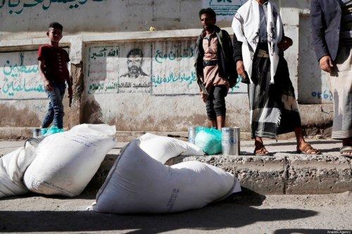 Yemenis receive food aid distributed by United Nations World Food Programme (WFP) in Sanaa, Yemen on 26 January 2021 [Mohammed Hamoud/Anadolu Agency]