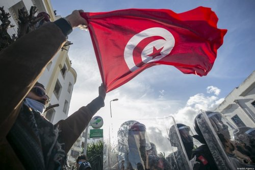 Police officers block the road as people stage a demonstration in Tunis, Tunisia on 26 January 2021 [Yassine Gaidi/Anadolu Agency]