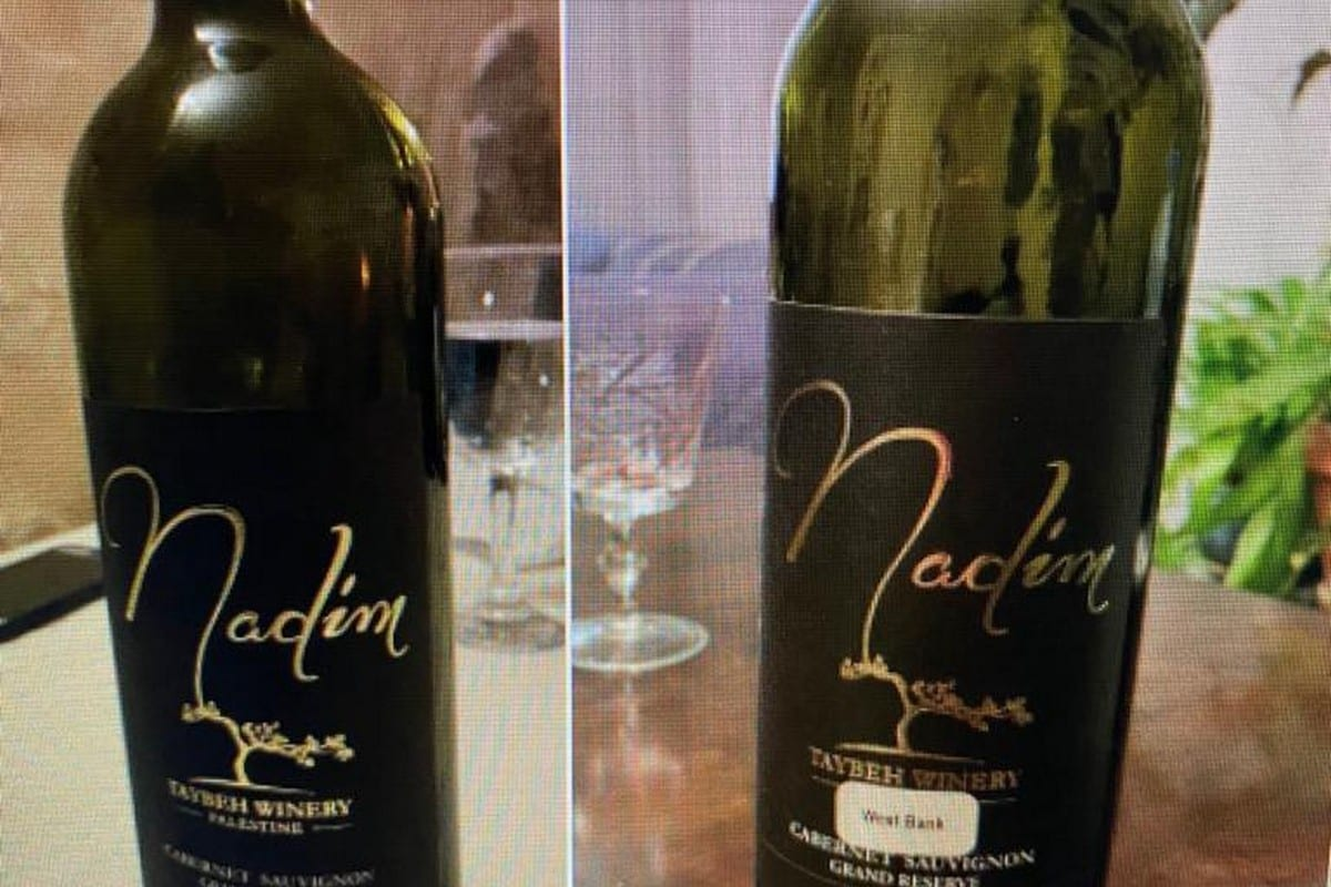 """A wine seller covered the word """"Palestine"""" on the label with a version saying """"West Bank"""" in Canada 11 January 2021 [Nyla.matuk/Facebook]"""