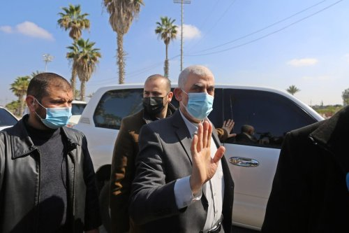 Hamas director Khalil al-Hayya and Palestinian leader of Hamas in the Gaza Strip Yahya Sinwar (C) with the leaders of the Palestinian groups leave the city at the Rafah Border Gate in Gaza to attend the national dialogue talks scheduled to begin tomorrow in Cairo, the capital of Egypt. in Rafah, Gaza on 7 February 2021. [Ashraf Amra - Anadolu Agency]