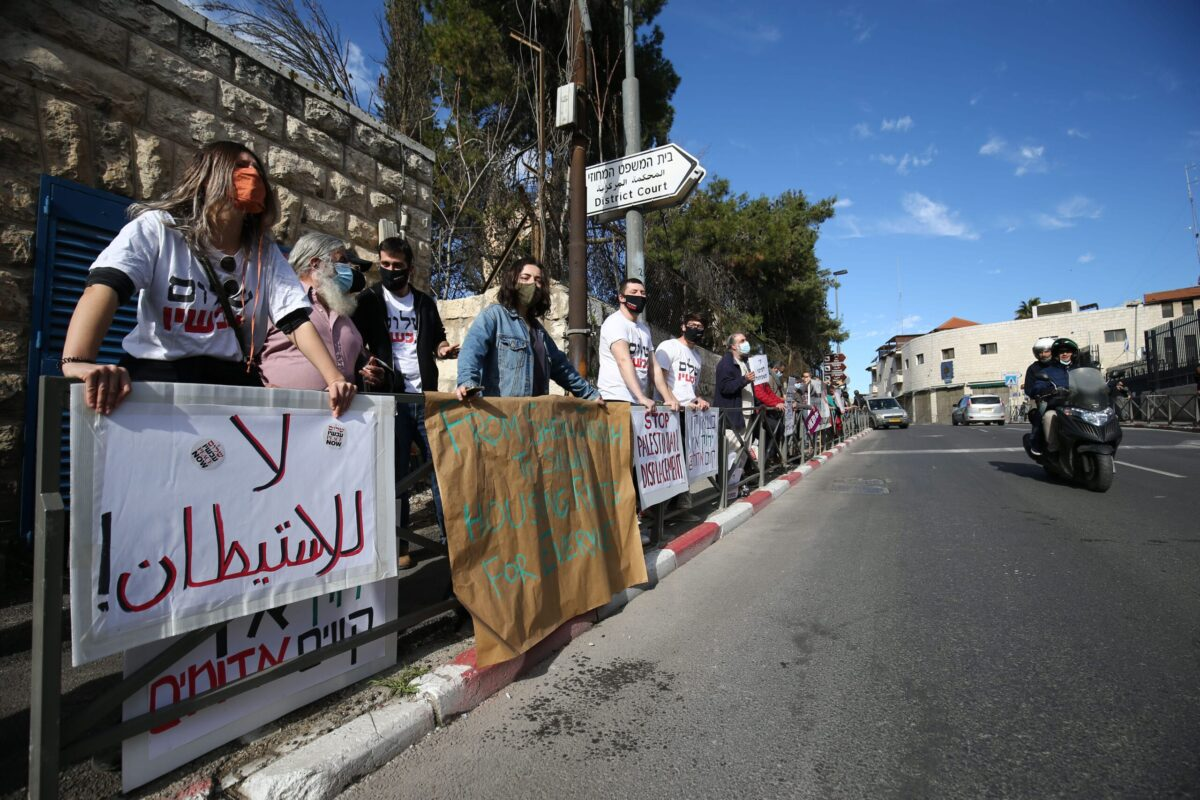 Palestinian and Jewish peace activists stage a protest against the court's ruling in favor of the Jewish settlers in front of the Israel Central Court in Jerusalem on 9 February 2021. [Mostafa Alkharouf - Anadolu Agency]