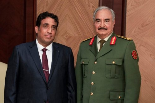 President of Libya's interim government Mohammad Younes Menfi (L) meets warlord Khalifa Haftar (R) in Benghazi, Libya on 11 February 2021. [Khalifa Haftar Forces Press Office - Anadolu Agency]