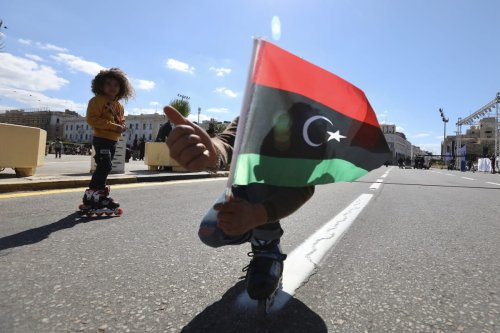 TRIPOLI, LIBYA - FEBRUARY 16: A kid waves Libyan flag as people celebrate Libyan Revolution, known as the 17 February Revolution, which ousted former ruler Muammar Gaddafi, at the Martyrs' Square in Tripoli, Libya on February 16, 2021. ( Hazem Turkia - Anadolu Agency )