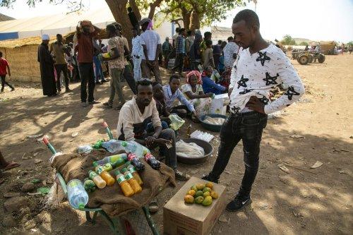 Ethiopians are seen at Um Rakuba refugee camp as they continue to live under harsh conditions in eastern Al -Qadarif State, Sudan on February 20, 2021 [Mahmoud Hjaj / Anadolu Agency]