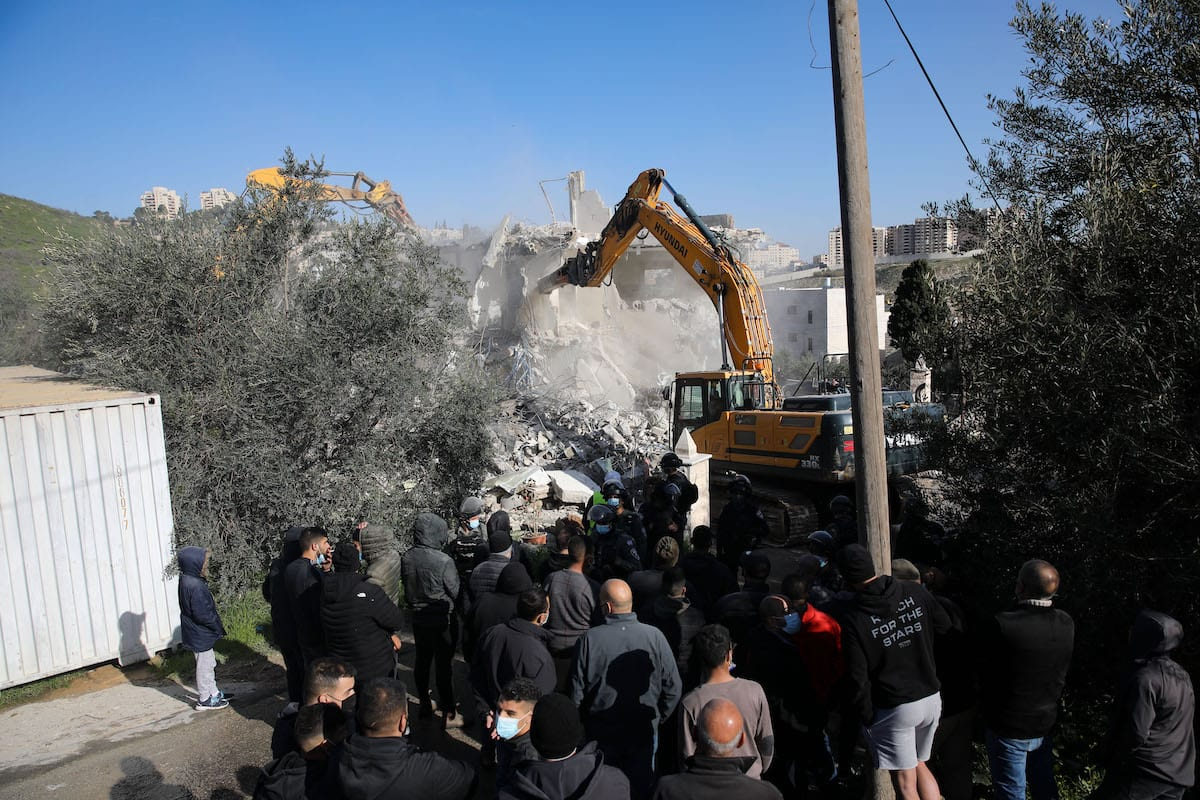 A view of the site as the Israeli-run Jerusalem Municipality team along with Israeli police and bulldozers demolishing the two-story apartment building owned by Fadi Ali Oleyyan, the head of the security department at the Al-Aqsa Mosque, near the al-Issawiya neighborhood claiming that it was unlicensed, in East Jerusalem on February 22, 2021. [Mostafa Alkharouf - Anadolu Agency]