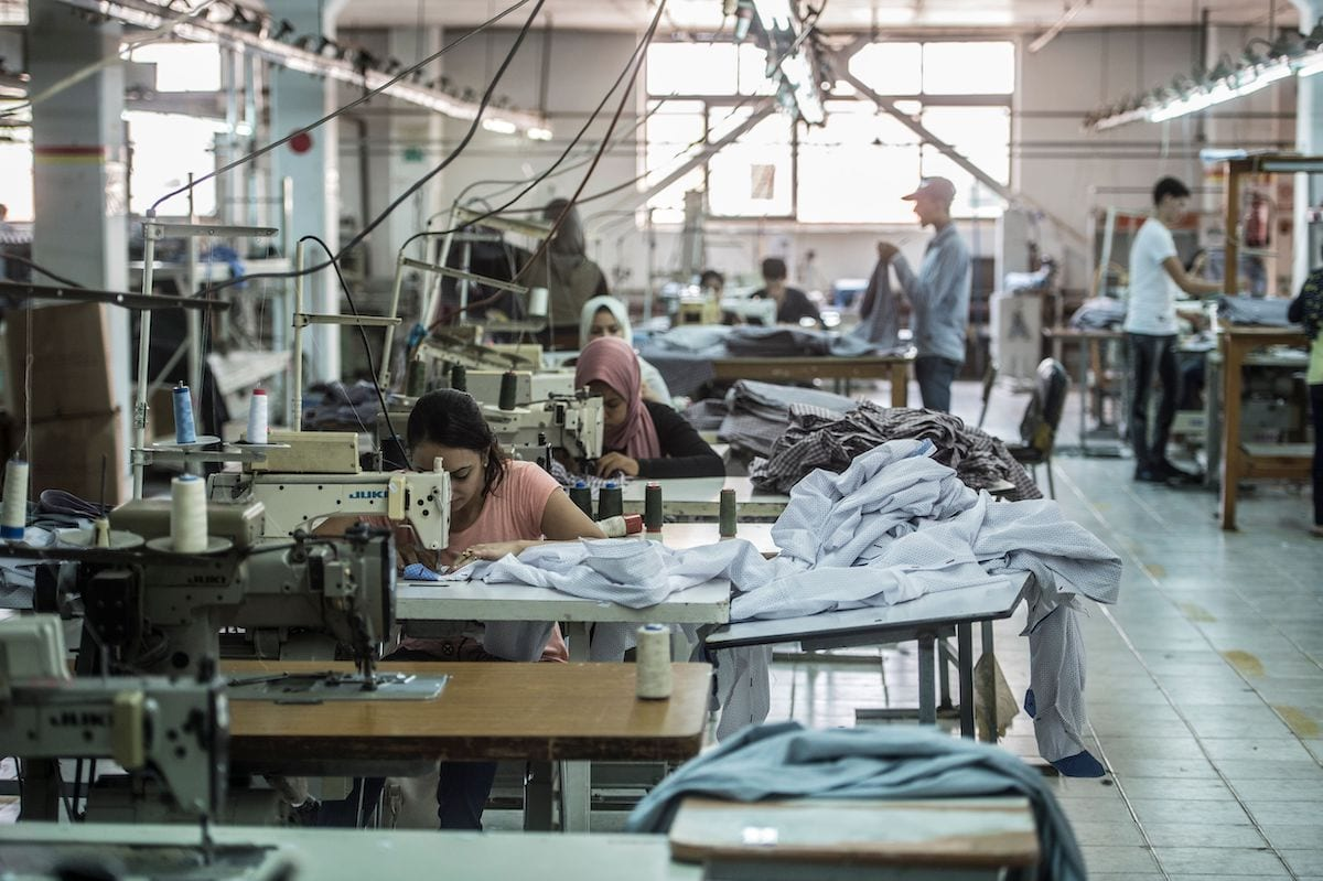 Tailors sewing at the Marie Louis textile clothing and textile factory in the 10th of Ramadan city, about 60 kms north of Cairo on 29 July 2018 [KHALED DESOUKI/AFP via Getty Images]