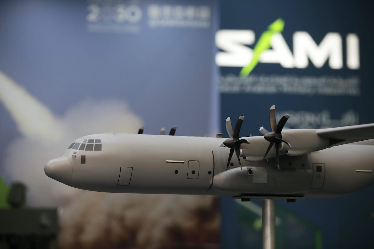 A model C130 military transport aircraft, manufactured by Lockheed Martin Corp., sits on the Saudi Arabian Military Industries Co. exhibition stand during the 53rd International Paris Air Show at Le Bourget in Paris, France, on 18 June 2019. [Jason Alden/Bloomberg via Getty Images]