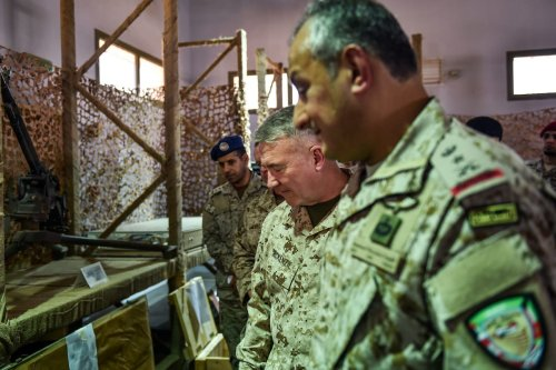 US Marine Corps General Kenneth F. McKenzie Jr. (C, behind), commander of the US Central Command (CENTCOM) and Lieutenant General Fahd bin Turki bin Abdulaziz al-Saud (front), commander of the Saudi-led coalition forces in Yemen, are shown reportedly Iranian weapons seized by Saudi forces from Yemen's Huthi rebels, during his visit to a military base in al-Kharj in central Saudi Arabia on 18 July 2019. [FAYEZ NURELDINE/AFP via Getty Images]