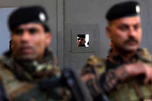 Iraqi policemen in the centre of the capital Baghdad on 22 December 2020 [AHMAD AL-RUBAYE/AFP/Getty Images]