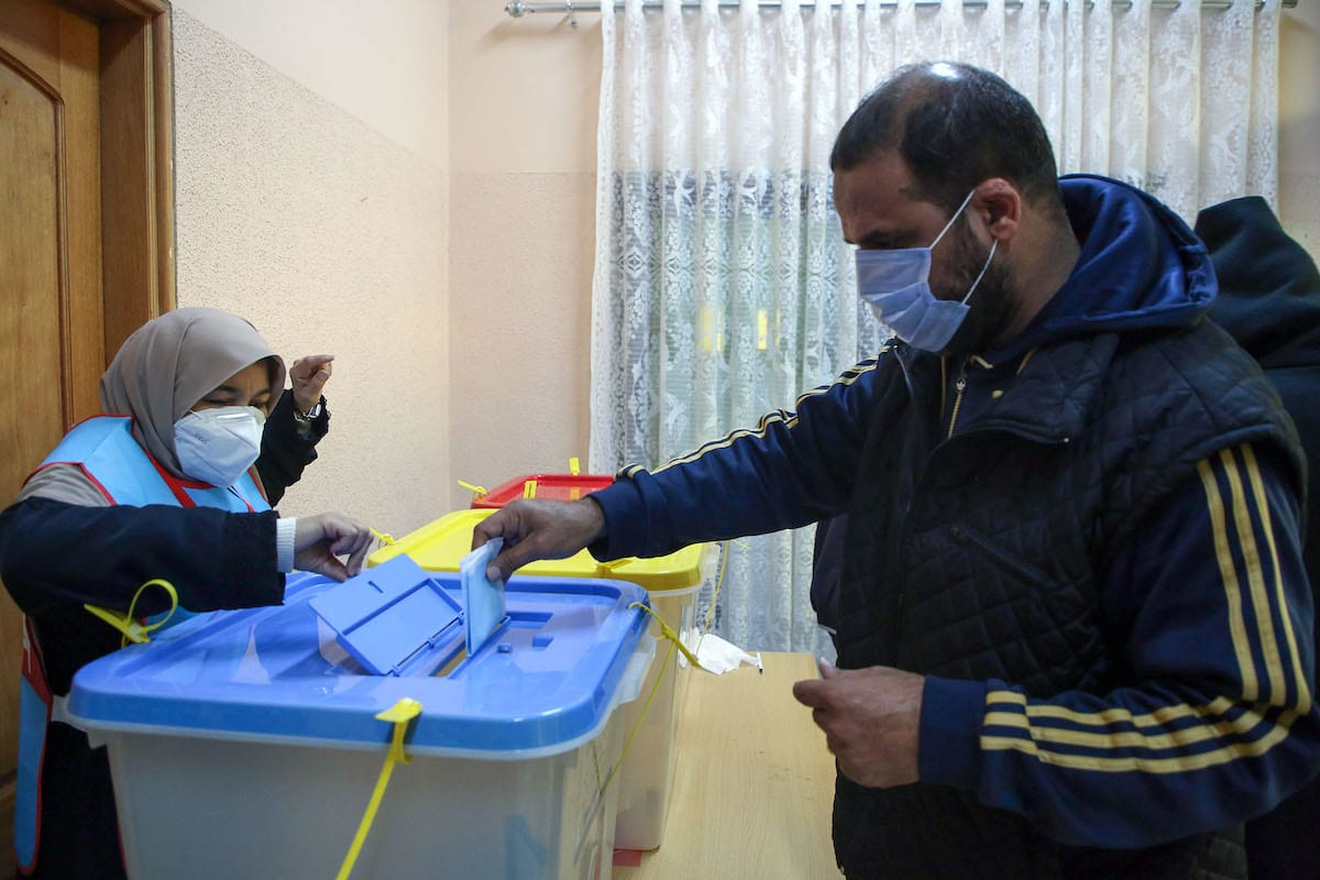 Libyans cast their ballots during the second round of municipal elections, at a voting center in the Andalus neighbourhood of the capital Tripoli, on 7 January 2021. [MAHMUD TURKIA/AFP via Getty Images]
