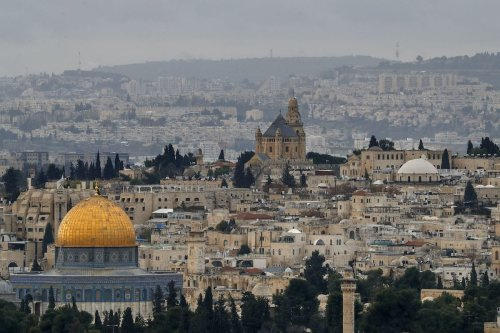 The Dome of the Rock (L), in the Al-Aqsa mosques compound and the Abbey of the Dormition in Jerusalem's Old City on 15 January 2021 [AHMAD GHARABLI/AFP via Getty Images]
